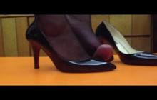 Whore in heels stomping a hard cock