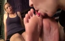 Licking her soles and toes