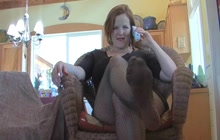 Mature lady teasing with her feet in fishnets