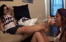 Cute lesbian babe licking her lover's feet