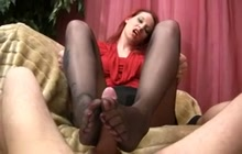 Redhead giving a great footjob
