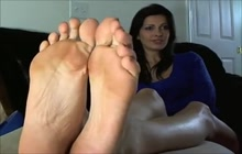 Dirty brunette MILF loves to tease with her feet