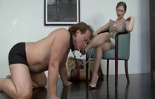 Submissive guy sucks mistress' feet