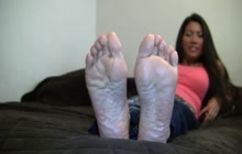 Asian MILF teasing with her feet