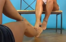 Horny lesbians with sexy legs and tender feet