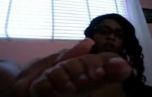 Ebony masturbating and teasing with her feet
