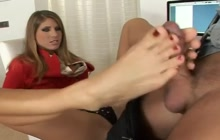 Jennifer Stone giving a footjob