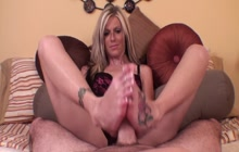Hot blondie giving an amazing footjob
